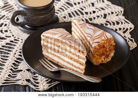 Beautiful Sliced Cake Eszterhazy And Coffee With Milk Close-up. Horizontal