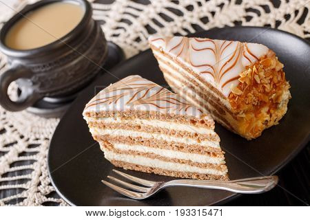 Two Pieces Of Esterhazy Cake On A Plate And Coffee With Milk Close-up. Horizontal