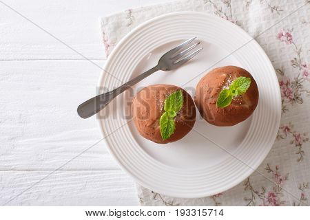 Austrian Rum Balls Cake With Mint Close-up On A Plate. Horizontal Top View