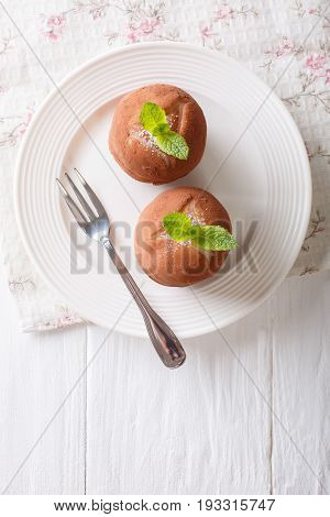 Austrian Rum Balls Cake With Mint Close-up On A Plate. Vertical Top View