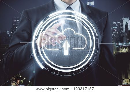 Businessman pointing at abstract upload cloud on night city background. Technology concept. 3D Rendering