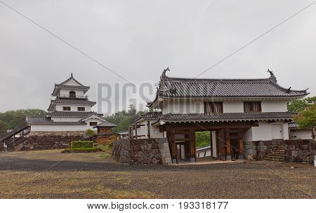 SHIROISHI JAPAN - MAY 25 2017: Reconstructed Main gate and Donjon (main keep) of Shiroishi Castle Japan. Castle was founded in 1591 by Gamo Ujisato and dismantled in 1875
