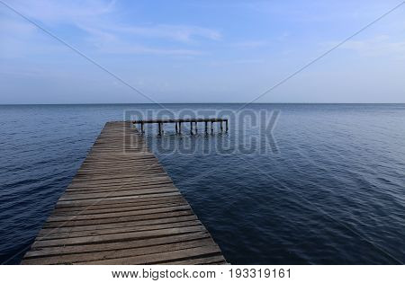 Wooden Boardwalk over Water, your way to.