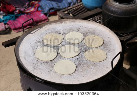 Baking tortillas on the fire - guatemalan pupusas - typical Kitchen Guatemala