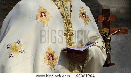 A priest of the Orthodox Church reads a prayer.