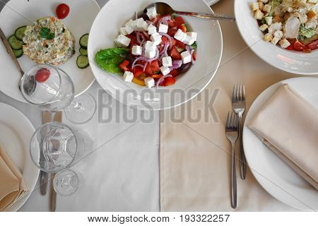 Top view of Cutlery in shades of beige and snack meals. Restaurant utensils for person. Classic Banquet table for a meal in the restaurant.