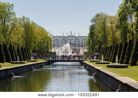 St. Petersburg, Russia, June 4, 2017: View of the Palace and fountains of Petergof. Palace and Park ensemble of Petrodvorets. Historical place visited by tourists.