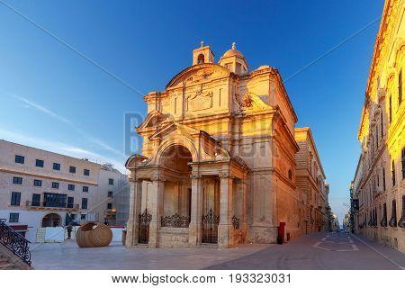 Catholic Church of St. Catherine of Alexandria or St. Catherine of Italy at sunset. Valletta. Malta.