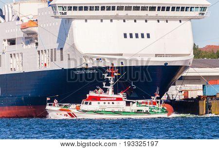 KIEL / GERMANY 20 JUNE 2017: sea rescuer Nis Randers from German Maritime Search and Rescue Service drives in harbour Kiel.