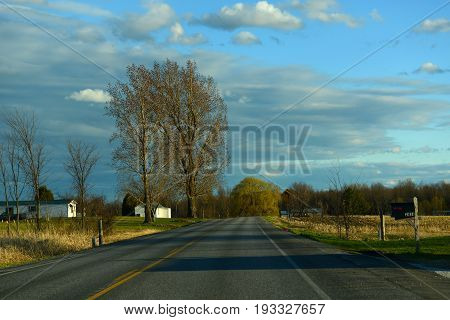 Country scene in early spring on US Route 2 near town of Alburgh in north Vermont, USA.