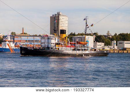 KIEL / GERMANY - JUNE 20 2017: german steam icebreaker Stettin drives through the water at public event Kieler Woche.