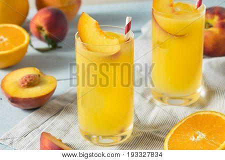 Refreshing Peach and Orange Fuzzy Navel Cocktail with a Garnish poster