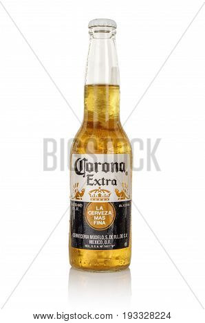 MINSK, BELARUS - JUNE 29, 2017: Editorial photo of bottle of Corona Extra beer isolated on white, one of the top-selling beers worldwide is a pale lager produced by Cerveceria Modelo in Mexico.