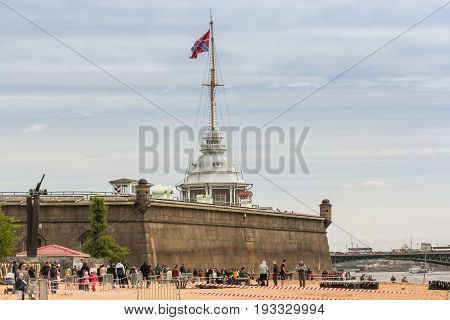 St. Petersburg Russia - 28 May, A mast with a flag above the fortress wall, 28 May, 2017. Famous sightseeing places of St. Petersburg for tourists.