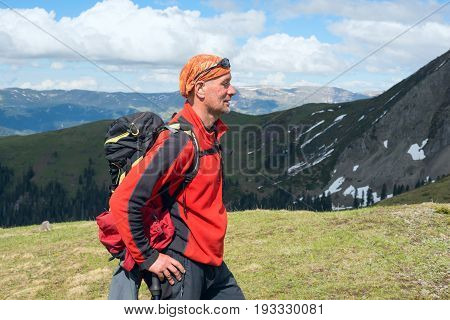 Man Traveler Stands On The Mountain Range