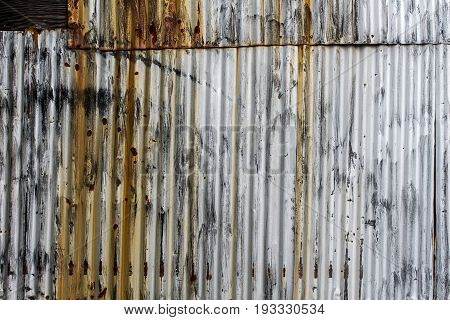 Abstract background texture - multi-colored rusted corrugated metal
