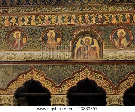 Bucharest, Romania - August 20, 2014: Facade of Stavropoleos Monastery in Bucharest, Romania on Lipscani Street was built in 1724. The name Stavropoleos means