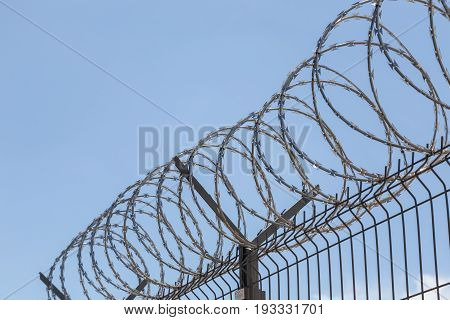 a round barbed wire on sky background