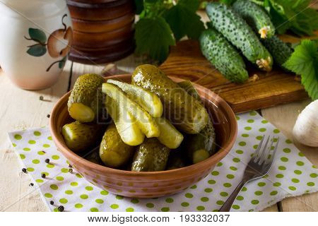 Marinated Cucumbers Gherkins. Marinated Quickly Salted Cucumber On The Kitchen Table.