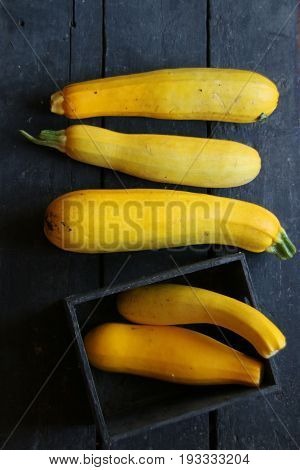 Raw Organic Yellow Zucchini on a wooden table