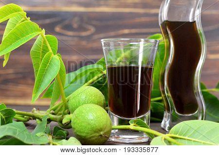 Close up of walnut liqueur in aglass