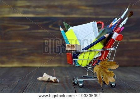Back to school: Shopping cart with school supplies