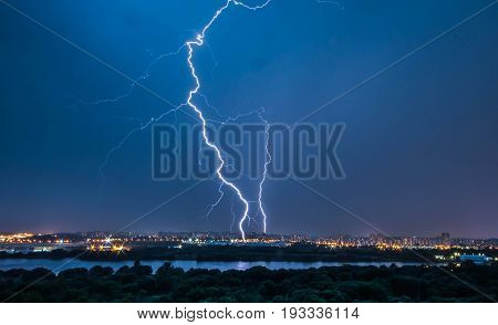 MOSCOW RUSSIA - 30 June 2017: Storm in Moscow. Panorama photo. Kapotnya Moskva Reka Maryno and Brateevo outskirts of UVAO Moscow Russia. Summer hurricane view of city park and Moscow River, bright lightning