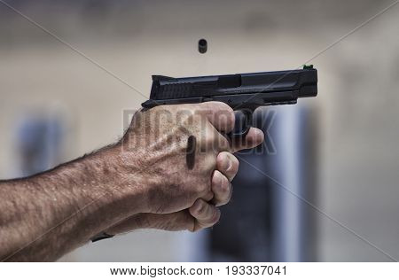 Semi automatic handgun with a single piece of brass flying out