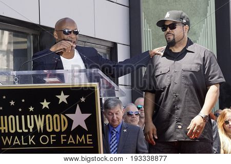 LOS ANGELES - JUN 12: John Singleton, Ice Cube at a ceremony as Ice Cube is honored with a star on the Hollywood Walk of Fame on June 12, 2017 in Los Angeles, CA
