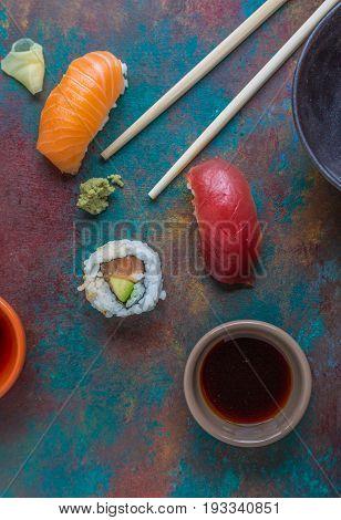 Sushi nigiri and California Roll on a blue plate
