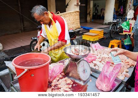 Butcher Sells Chicken Meat At The Wet Market Of George Town
