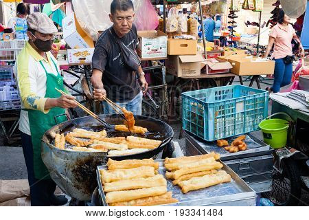 Men Cooks Youtiao At The Street Market