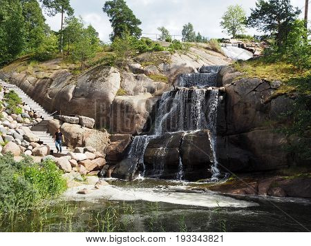 Amazing waterfall in finish Kotka with rocks around and stairs for tourists