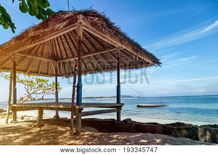 Wooden bungalows with thatched roof on the beach