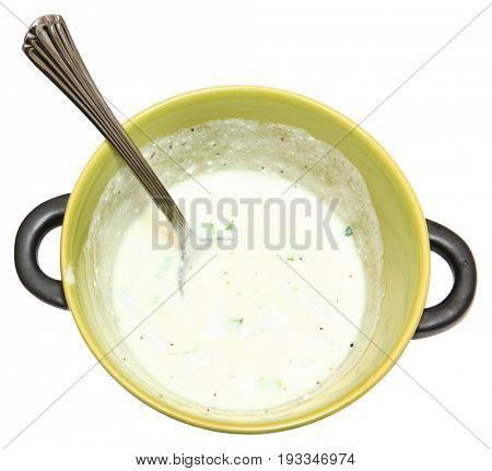 Bowl of Pepper Lime  Sour Cream over white.