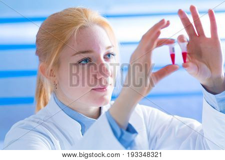 Woman student with pcr devices in medical laboratory