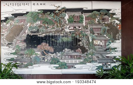 Suzhou, China - Nov 5, 2016: Map of the Master of Nets Garden (Wang Shi Yuan) near the entrance; depicted as a painting in the classical Chinese style.