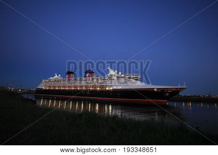 IJmuiden the Netherlands - May 25th 2017: Disney Magic leaving North Sea lock IJmuiden.