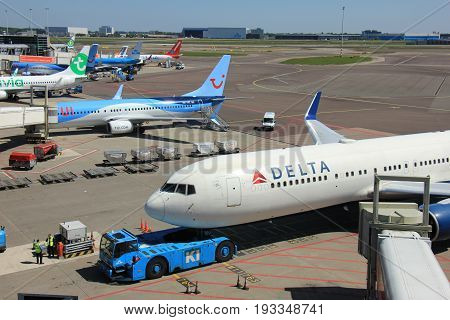 Amsterdam The Netherlands - May 26th 2017: Aircrafts of various airlines parked at Amsterdam Schiphol International Airport