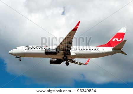 SHEREMETYEVO MOSCOW REGION RUSSIA - June 28 2017: Boeing 737-800 of Nordwind Airlines makes a landing at Sheremetyevo International Airport.