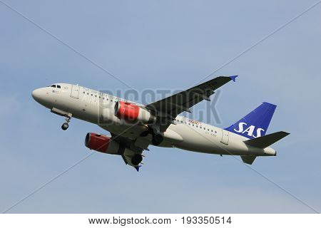 Amsterdam the Netherlands - June 2nd 2017: OY-KBR SAS Scandinavian Airlines Airbus A319 taking off from Polderbaan Runway Amsterdam Airport Schiphol