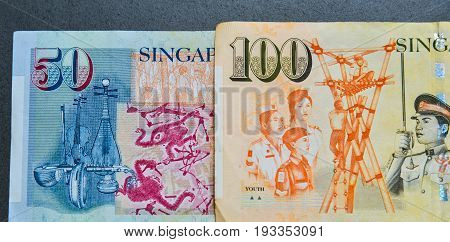 Details of Singapore banknotes (50-100 SGD) - currency concept - close up. poster