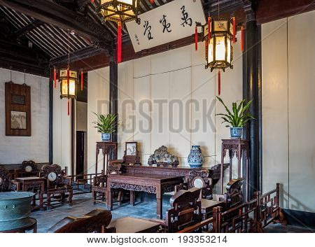 Suzhou, China - Nov 5, 2016: Master of Nets Garden (Wang Shi Yuan), featuring the Hall of 10000 Volume front court showcasing classical Chinese architecture and furnishings.