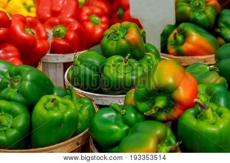 Fresh Ripe Red Sweet Bell Pepper In Box On Sale At Grocery Food Store.