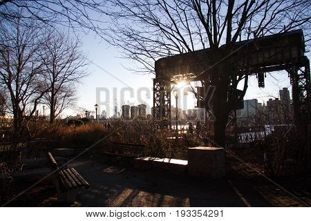 The back iconic gantries of Gantry State Park in silhouette with sunset