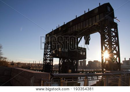 iconic gantries of Gantry State Park and fence with blue sky before sunset