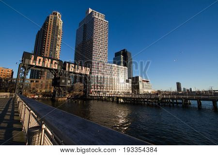 Transfer bridges, support gantries, and piers in the Gantry Plaza State Park and Buildings with blue sky, New York