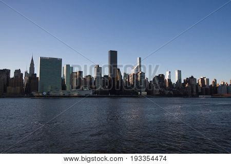 Buildings in Manhattan under the shade and East river, New York