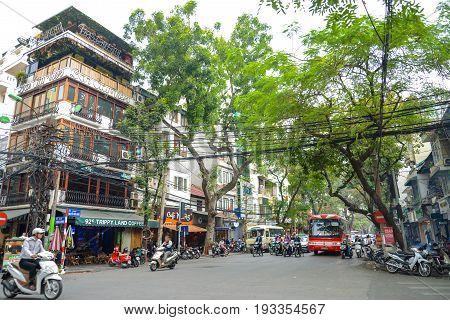 Hanoi Vietnam - Feb 20 2017 : Hanoi street in the morning. Popular transportation in Hanoi street is motorbike.