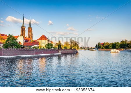 Picturesque Scene Of Famous Tumski Island With Cathedral Of St. John On Odra River